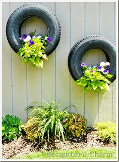 Wall flowerpots made from old car tires. Why didn't I think of that! If anyone wants tires for this project, I can hook you up!