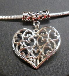 ^ Antique Silver tone Euro Heart Pendant. Starting at $5