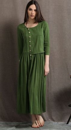 Welcome to my shop and thanks for your interested to the moss green linen dress.It is a casual linen dress,has round collar,three quarters of the sleeve,has a side zipper,no lining.the pocket in front of bust and the wooden buttons are decoration of this dress.Asymmetrical semi-fitted waist