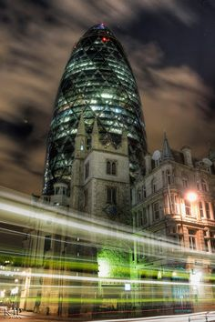 The Gherkin and previously as the Swiss Re Building