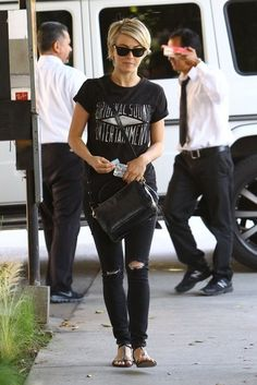How To Wear Distressed Denim // Julianne Hough goes for a rocker look with a band tee + torn jeans