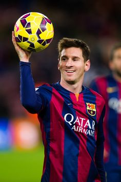 Lionel Messi of FC Barcelona with the match ball after scoring three goals during the La Liga match between FC Barcelona and RCD Espanyol at Camp Nou on December 7, 2014 in Barcelona, Catalonia.