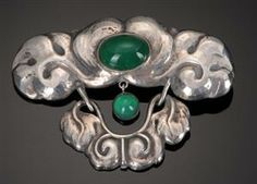 Evald Nielsen, Skonvirke brooch of .830 silver, set with an oval and a round cabochon cut green agate.
