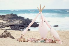 Planning + Styling: La Fleur Weddings & Events - lafleurweddings.com Photography: Simply Bloom Photography - simplybloomphotography.com/ Flowers: Yvonne Design - yvonnedesign.com/  Read More: http://www.stylemepretty.com/2012/01/09/oahu-beach-inspiration-photo-shoot-by-la-fleur-weddings-simply-bloom-photography/