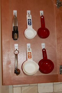 Measuring cups space saver. Much better than shoving them in a drawer.