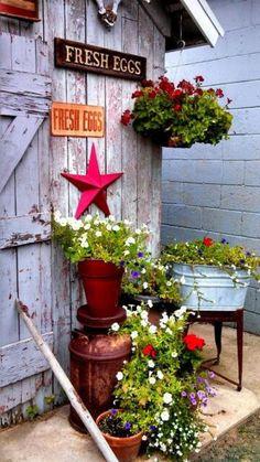 cabanon de jardin, mettre des pots de fleurs devant l'abri de jardin