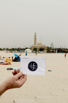 The #tripfictionpostcard pops up at the beach in Jumeirah, DUBAI - choose your next book by location and discover a place through the eyes of an author www.tripfiction.com