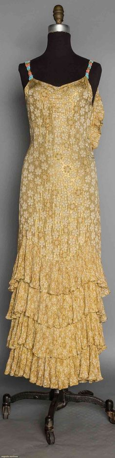 PRINTED GOLD LAME EVENING GOWN, 1930's | White blossom print on gold lame faille ground, bias cut, shoulder straps covered in rhinestones & beads, tiers of tiny accordian pleated flounces on skirt & edging low back