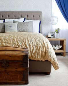 Love the headboard and comforter. Little touch of curtain is also nice.