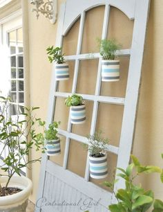 Start a vertical herb garden by placing plants in painted quart- or gallon-sized paint cans and hanging them from an old screen door frame. Get the tutorial at Centsational Girl.