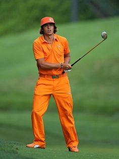 Golfer dressed in Orange Cap, Orange Polo Shirt, Orange Khaki's and Orange Shoes