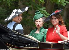 Princess Eugenie waves to the crowds as she travels by carriage with her sister and aunt P...