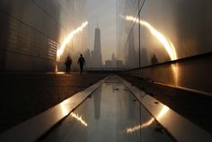 IlPost - A man walks through the 9/11 Empty Sky memorial at sunrise across from New York's Lower Manhattan and One World Trade Center in Liberty State Park in Jersey City, New Jersey, September 11, 2013. (REUTERS/Gary Hershorn/Files) - A man walks through the 9/11 Empty Sky memorial at sunrise across from New York's Lower Manhattan and One World Trade Center in Liberty State Park in Jersey City, New Jersey, September 11, 2013.  (REUTERS/Gary Hershorn/Files)