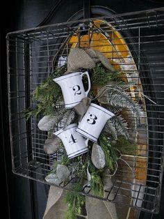 Interesting layers...silver tray, wire basket, burlap, greenery, etc.