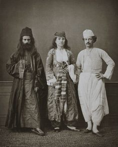 Traditional costumes of (from right to left) a Christian resident of Magossa (Famagusta, Cyprus), a Christian woman of Magossa, and a Greek monk of the Monastery of Tchiko, near Lefke (Lefka, Cyprus). From the album Les costumes populaires de la Turquie en 1873