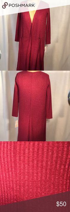 Sweater Lularoe Sarah in a cranberry color with a textured stripe. Some stretch to this sweater. 97% polyester and 3% spandex. LuLaRoe Sweaters Shrugs & Ponchos