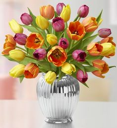 This spring, send your friends or family a vibrant bouquet of multicolored tulips to make it a season to remember.