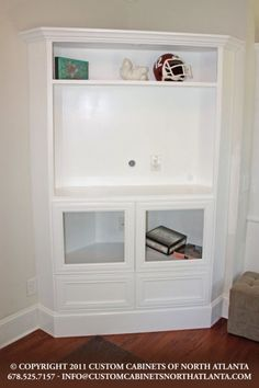 Corner cabinet i like how they made this look built it by matching the footboard and molding