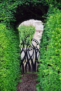 I MUST have pinned this before. I love the whimsical shape of the entry and OF COURSE, I love the gate. Lovely little pops of fragrant posies that lily of the valley are.