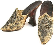 What were shoes like in the 18th century?  Pair of late 17th – early 18th century mules with fine silver embroidery on the vamp and red Moroccan leather heel.