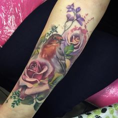 """Added this little robin and peach/lilac rose today. The bottom rose and leaves are healed"""