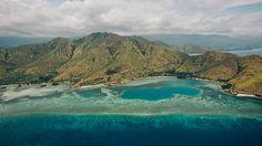 Vista aérea da costa de Díli, capital do Timor-Leste, país de língua portuguesa na Ásia. Créditos: yeowatzup / Fonte: Flickr