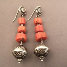 """On my website www.halter-ethnic.com under the item """"My Lucky Finds"""" this nice pair of earrings in silver with very good quality of 6 coral beads ...coming from North India and dating of the first half of last century..."""