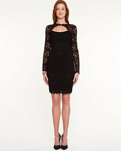 Lace Illusion Dress - A lace fabric and seductive cut-out combination define this elegant fitted cocktail dress.