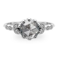 1.95 Carat Grey Diamond Engagement Ring- Clover SettingThe ring features a beautiful unique 1.95 carat rose cut diamond. The rose cut diamond is a top quality certified natural grey diamond. The rose cut diamond is translucent with marb...