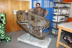 """""""Mabel"""" the Tyrannosaurus Rex skull is a 5 foot long dino cutie made out of Papier-Mâché and 500+ hours of effort."""