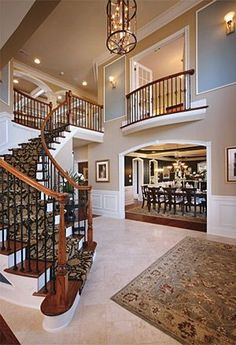 curved staircase with balcony opening into foyer. Really like these stairs! Villa Plan, Curved Staircase, Staircase Design, Iron Staircase, Entryway Stairs, Entryway Ideas, Entrance Ideas, Wood Stairs, House Entrance