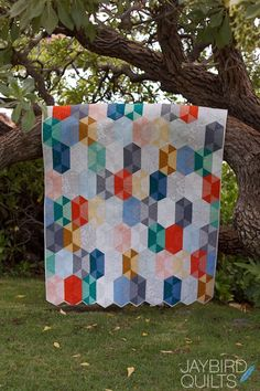 Disco Quilt | Jaybird Quilts -- Use #AccuQuilt dies to cut the shapes for your own version of this project at http://www.accuquilt.com/new/go-half-hexagon-4-1-2-sides-4-1-4-finished.html & http://www.accuquilt.com/new/go-equilateral-triangle-4-1-2-sides-4-1-4-finished.html!
