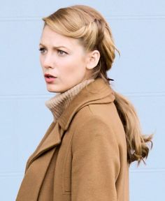 "Knowing that you ladies are always in the market for an easy way to pretty up your ponytail, I just had to pass along this photo of Blake Lively on the set of her upcoming film Age of Adaline in Vancouver yesterday. This low pony has twists that resemble 1940s ""victory rolls""—a hairstyle many of our grandmothers wore. We've seen rolled hairstyles like this around quite a bit lately (I have a separate Pinterest board for them!), and I think the idea is so classic and beautiful. The ..."