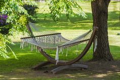 The simple addition of a hammock in a quiet corner of your garden can give you the perfect spot to read a book. Garden Hammock, Simple Addition, Outdoor Furniture, Outdoor Decor, Garden Landscaping, Landscape Design, New Homes, Corner, Gardens