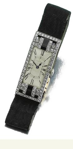 LADY'S ONYX AND DIAMOND WRISTWATCH, CARTIER, 1924  The dial with black Roman numerals, bordered with millegrain set rose-cut diamonds, the lugs set with black onyx and similar diamonds, to the black silk strap and deployant buckle, mounted in yellow gold and platinum, circumference approximately 140mm, dial signed Cartier, case numbered, buckle numbered, French assay and indistinct maker's marks.