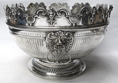 Antique Queen Anne Style Silver Monteith Bowl by CHARLES STUART HARRIS   A large and handsome antique sterling punch bowl in the early 18th century style with lions mask side handles, typical ribbed body decoration and a decorative cartouche to the front. The shaped scalloped rim is detachable; this is used to hold stem glasses, punch ladle and lemon squeezer and a bowl of this type is referred to as a Monteith.- waxantiques