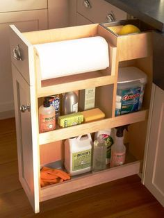 I like this solution for papertowels but where to put it? Lower cabinet to right of stove?.... Source: Storage solutions for cleaning supplies in kitchen.