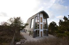 The Dune House - personally designed three-story structure that sits between the sea dunes by Jetty and Maarten Min