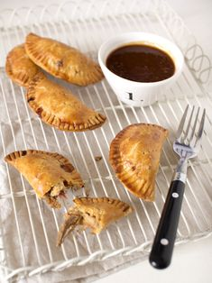 Substitute your favorite gluten free flour mix and you got... pulled pork empanadas with peach barbeque sauce (recipe)