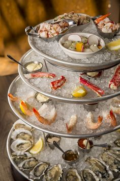 """Seafood towers. Phil Vettel outlines the options in Chicago Tribune dining section. Shown here: """"The grandest platter in Chicago (and the priciest) is the Kinmont tower ($190), a four-tiered tribute to shellfish excess that will put you in a seafood swoon. (Brian Cassella, Chicago Tribune)"""""""