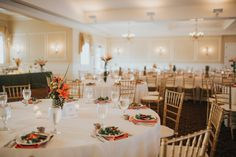 The River House, Coral & Green Wedding. Birds of paradise wedding florals and plated salad meal option.