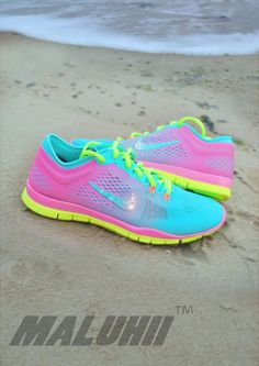 $119.96 discount to $49.98 TROPICAL TWIST PINK GLOW AND VOLT NIKE TR 4 TRAINERS