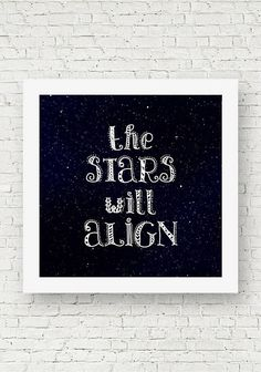 "An inspirational square quote print that reads, ""The stars will align."" Black and white typography wall art."