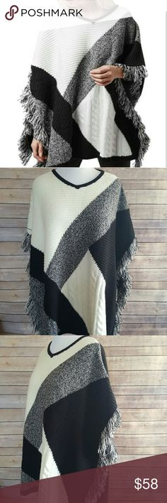 """Topshop Colorblock Fringy V Neck Poncho One size 27.5"""" Length V Neckline 100% Acrylic Hand wash cold, dry flat One size No size or content tag, details from nordstroms.com (sold out) Black and white (more of an Ivory color than white) Topshop Sweaters Shrugs & Ponchos"""
