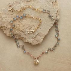 """Izadora Necklace: Sundance  Faceted labradorite sparkles like raindrops amidst the warm glow of heliodor and sun stone. The wire wrap is 14kt rose gold; the diamond-set charm, 14kt yellow gold. Handmade by Jes MaHarry in USA. Exclusive. Approx. 18-1/2""""L.$1,490.00"""
