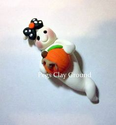 Halloween ghost Pendant or Bow Center holding by PegsClayGround