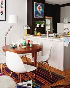 round dining table in front of open kitchen
