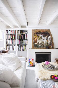 See more images from Jenni Li and Hans Gissinger: The Ultimate Family-Friendly Home Remodel on domino.com - Yarn stored in glass container.  Pretty.