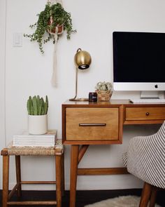 """""""This little office space is slowly coming along. Looking to maybe add some shelving above the computer. Found this cute @nateberkus side table/stool at…"""""""