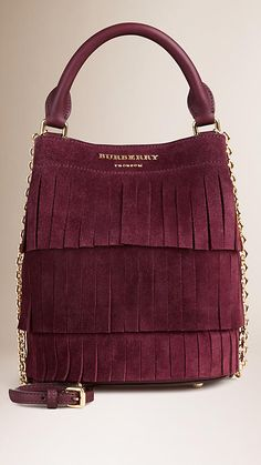 Burberry Elderberry The Small Bucket Bag in Tiered Suede Fringing - The Small Bucket Bag in tiered English suede fringing. Inspired by the runway, the design is made in Italy with hand-finished details.  Discover the women's bags collection at Burberry.com